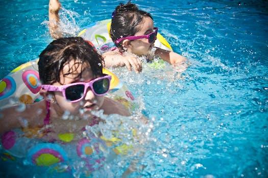 2 Girl's Swimming during Daytime