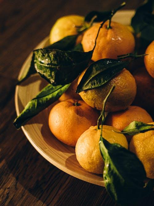 Orange Fruits on Brown Wooden Round Plate