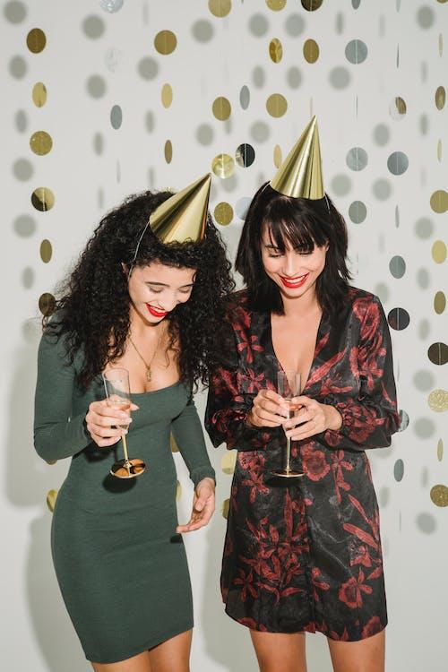 Stylish women with champagne celebrating holiday