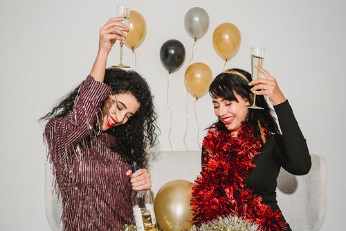 Happy women with glasses of champagne making toast