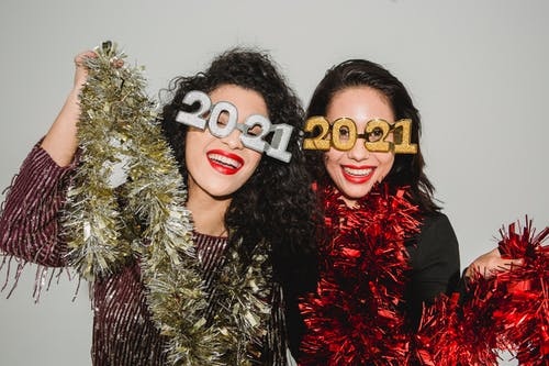 Happy girlfriends having fun at New Year party