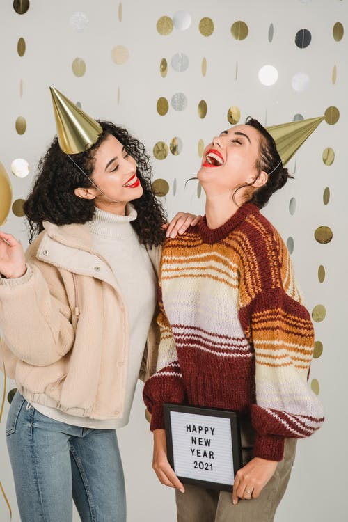 Laughing females enjoying New Year celebration