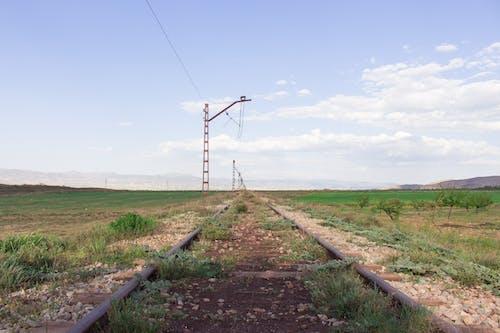 Foto profissional grátis de azul, caminho, céu nublado, ecológico