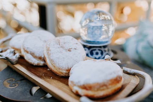 Close-Up Photo Of Fresh Doughnuts On Wooden Tray