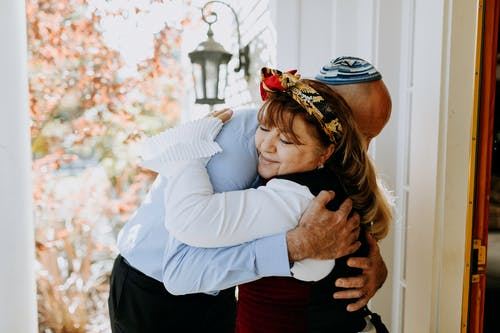 Photo Of Man And Woman Hugging Each Other