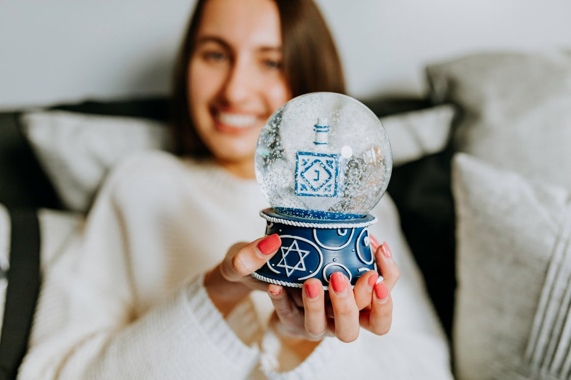 Photo Of Woman With A Snow Globe On Hands