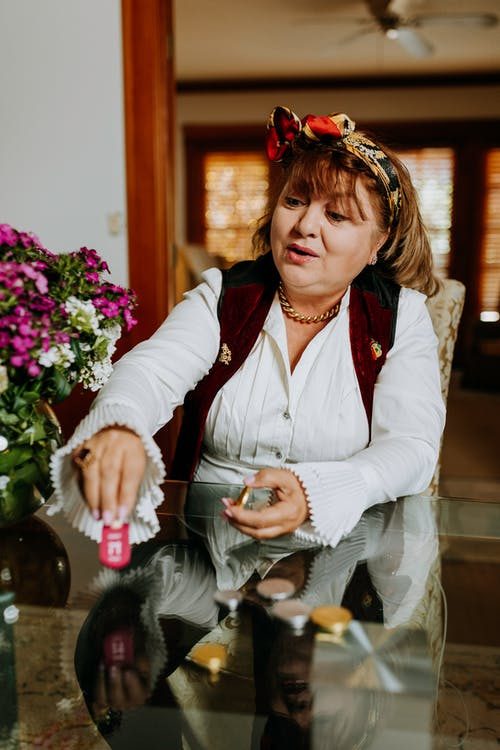 Photo Of Woman Playing Dreidel