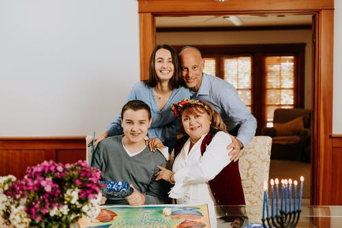 Photo Of Family Gathered Beside Dining Table