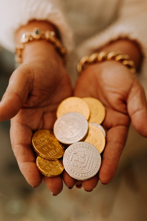Photo Of Person Holding Gold Round Coins