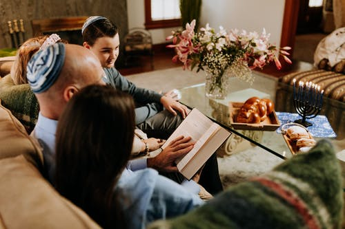 Photo Of Man Reads For His Family