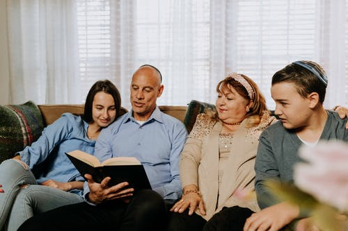 Photo Of Family Seated Together