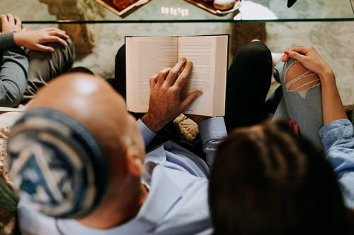 Photo Of Man Reads The Book To His Daughter