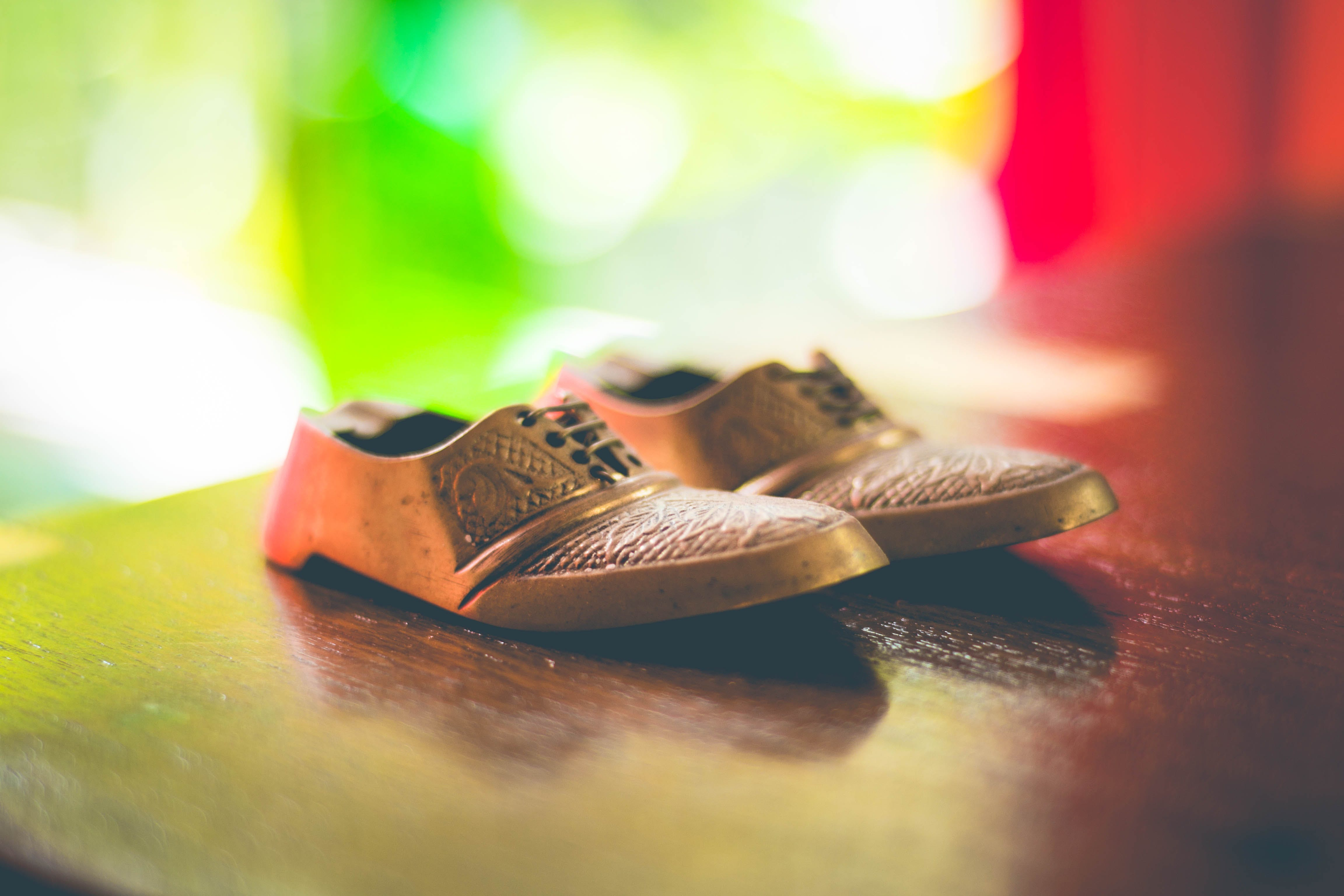 Free stock photo of bokeh, boots, brass, carvings