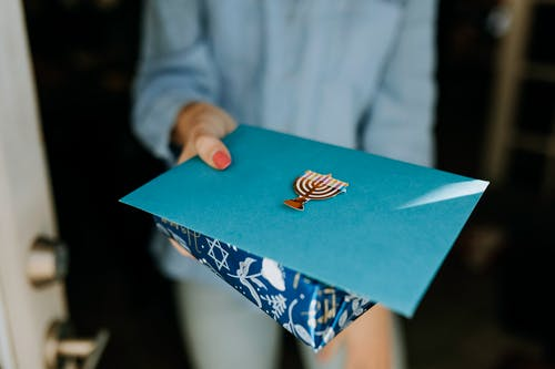 Photo Of Person Handing A Gift