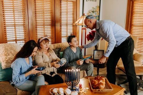 Photo Of Family Exchanging Gifts