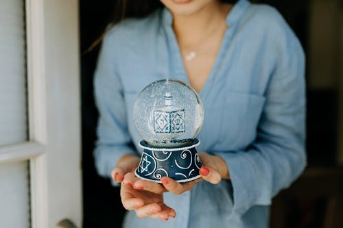 Photo Of Woman Carrying A Snow Globe