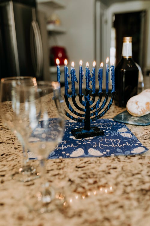 Photo Of Candle Holder Besides Wine Glasses