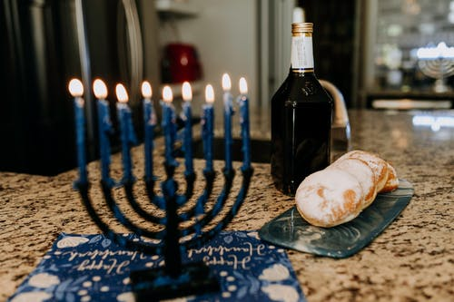 Black Wine Bottle on Blue and White Table Cloth