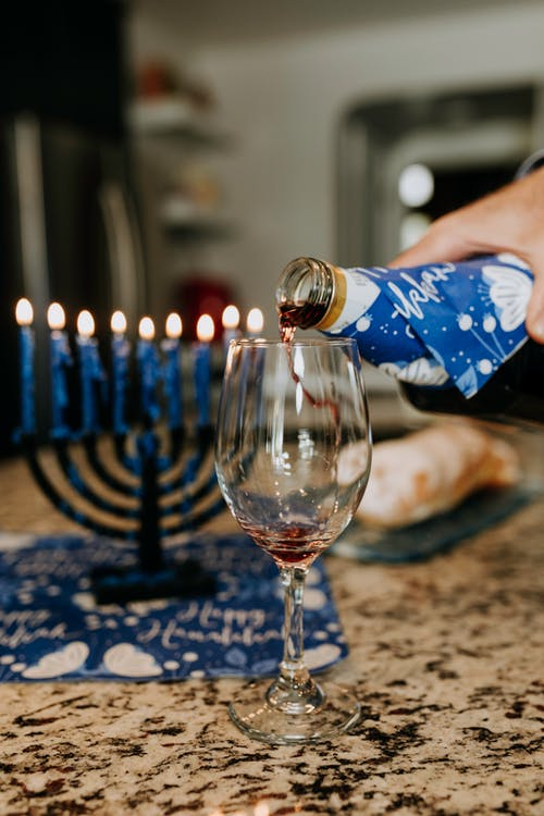 Photo Of Person Pouring Wine On Clear Wine Glass