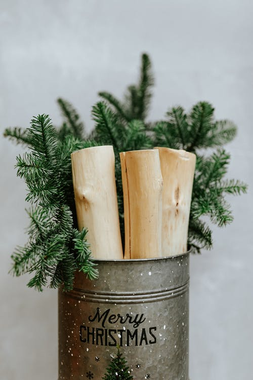 Brown Wooden Stick on Gray Steel Bucket