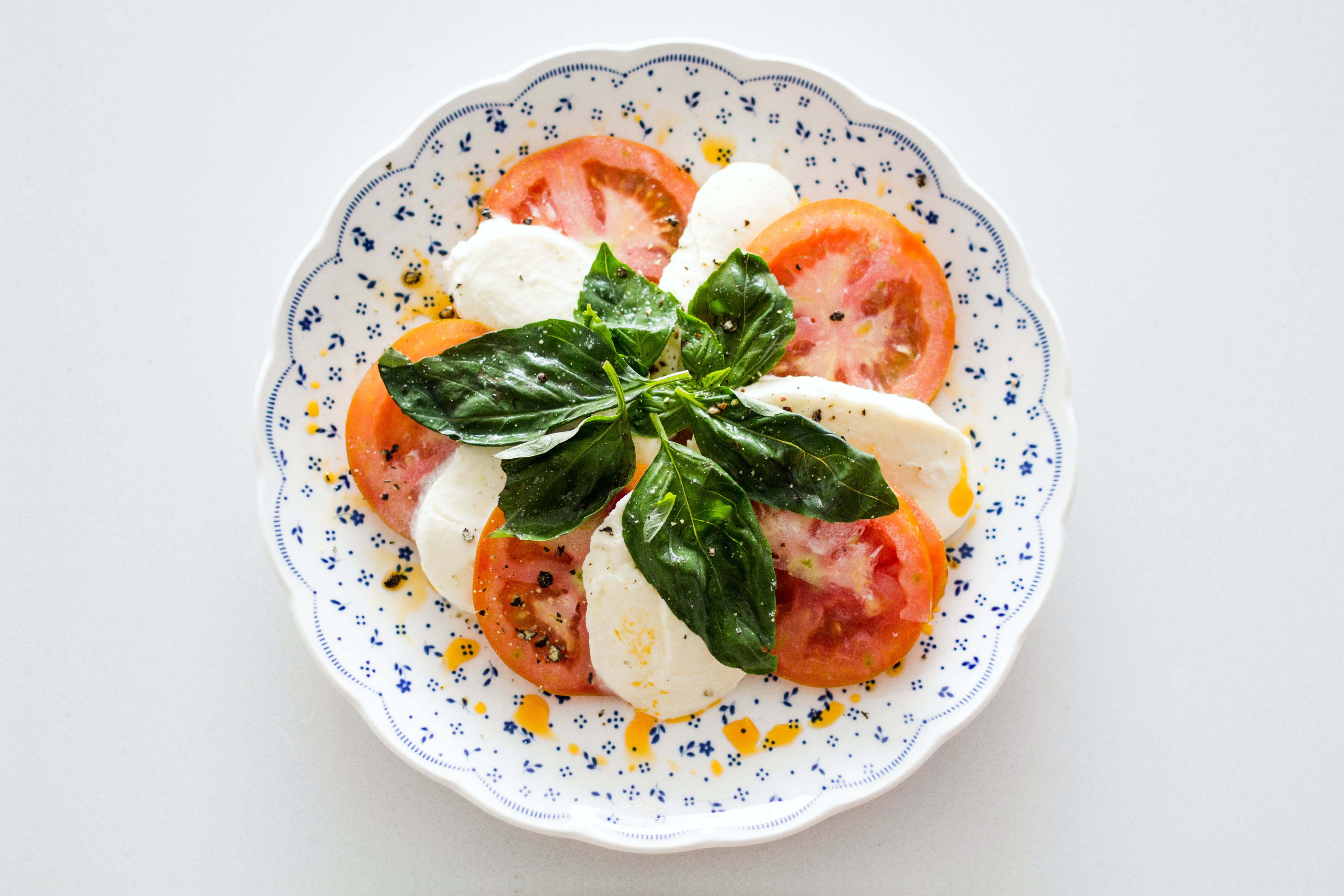 Vegetable Salad on White and Blue Round Floral Plate