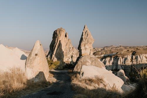 Old road between sharp rocks in desert