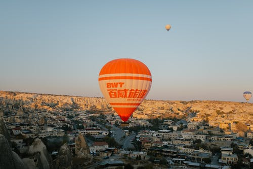 Big air balloon flying over eastern city