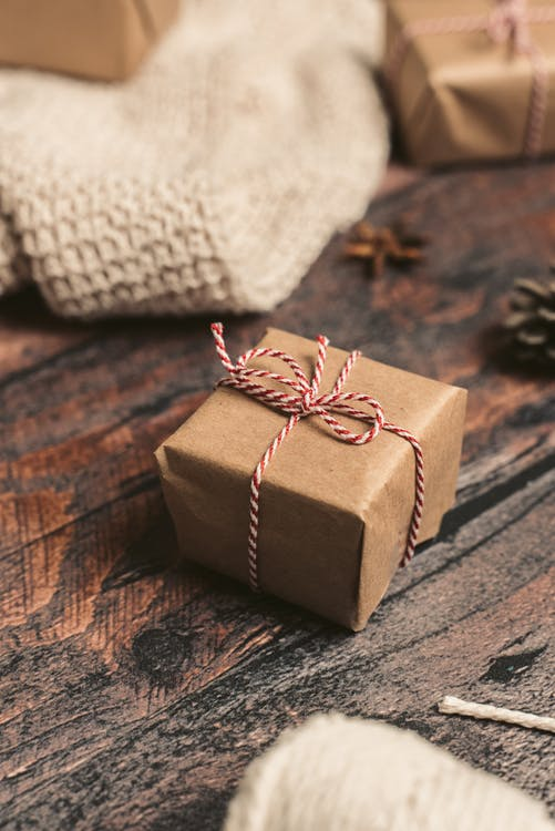 Brown Gift Box on Brown Wooden Table
