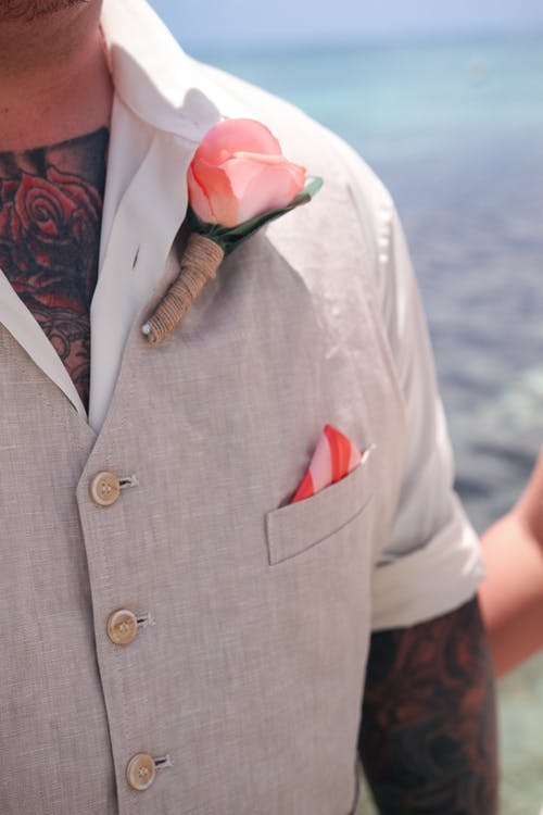 Man in White Button Up Shirt With Red Necktie