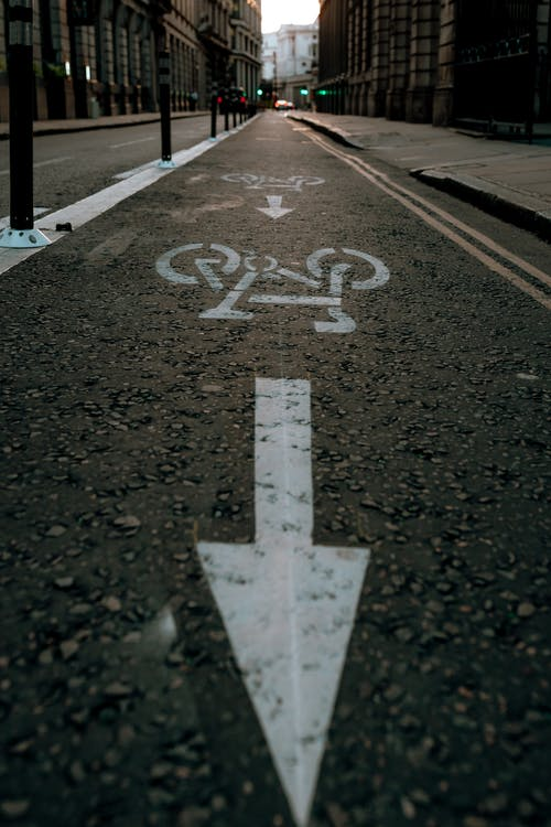 White Arrow Signs on Bicycle Lane