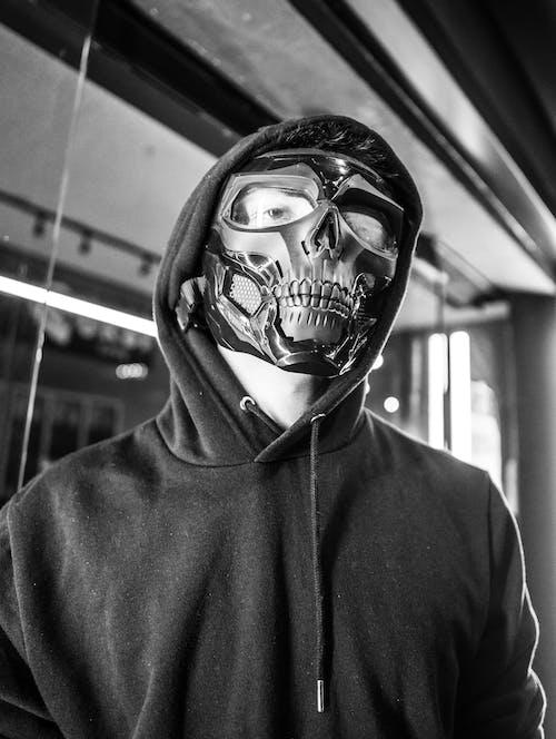 Person Wearing Black Hoodie and Black Skull Mask