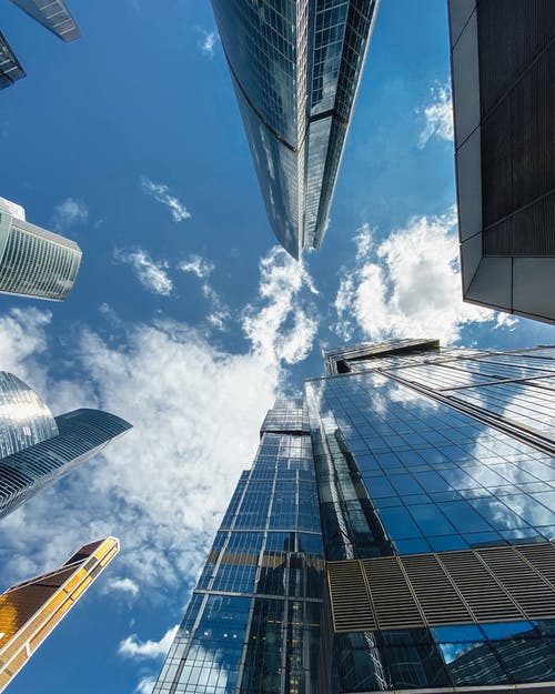 Moscow city skyscrapers facades under partly cloudy sky