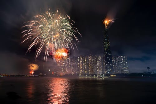 Glowing fireworks on dark sky