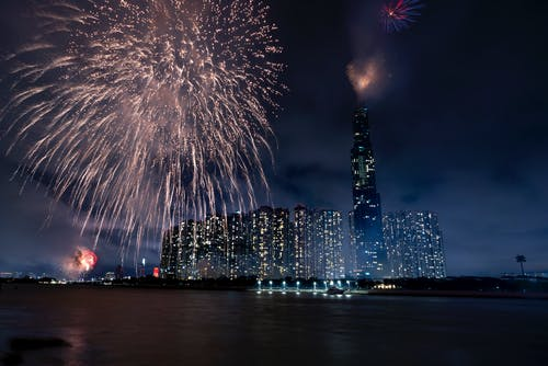 Night cityscape with festive fireworks