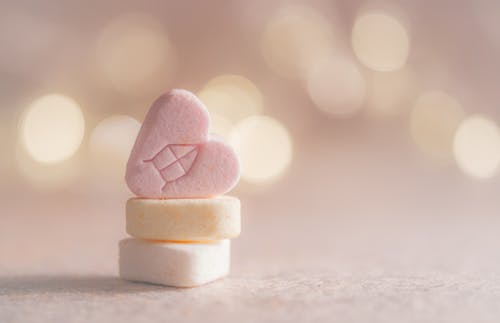 Three Beige, Yellow, and Pink Heart Marshmallows