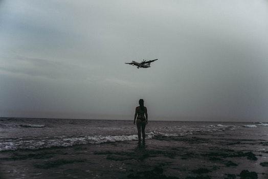 Grayscale Photography Of Woman On Seashore