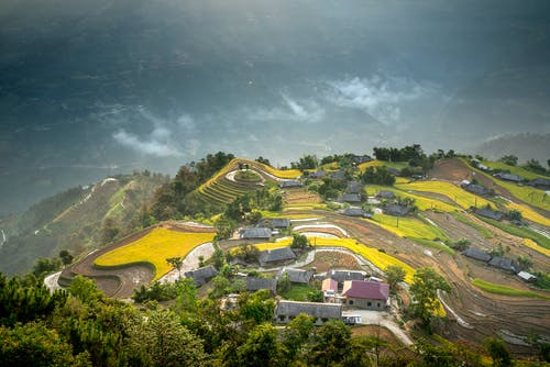 Picturesque scenery of rural area on lush hilltop
