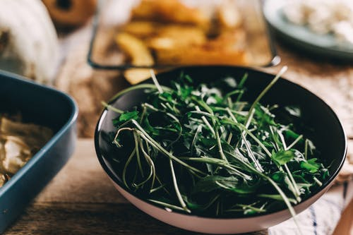 Close-Up Photo of Green Vegetables in a Bowl