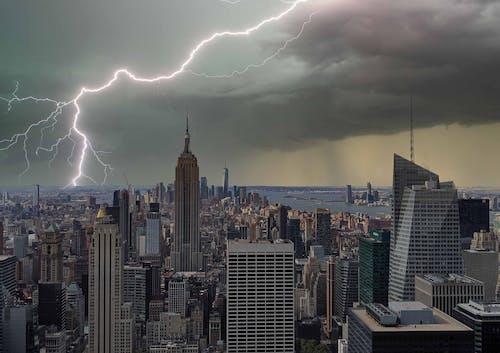 A Lightning Strike over City Buildings