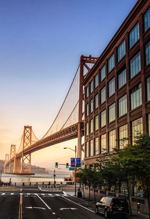 Brown Metal Bridge Near Building