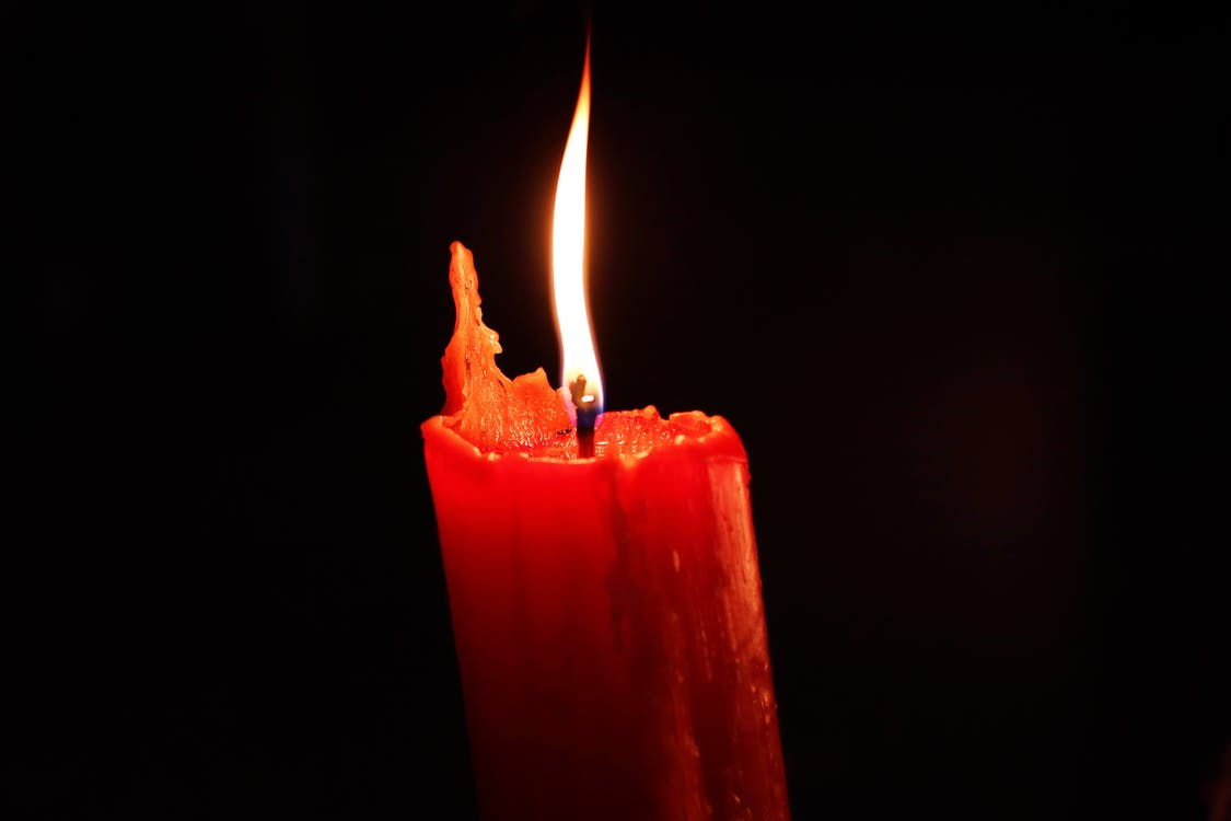 Red Pillar Candle With Black Background