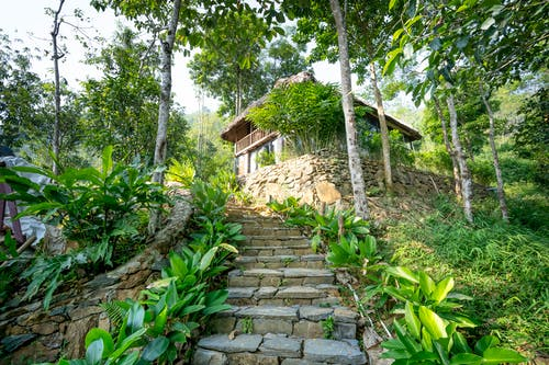 Old stone outdoor stairs to small cottage