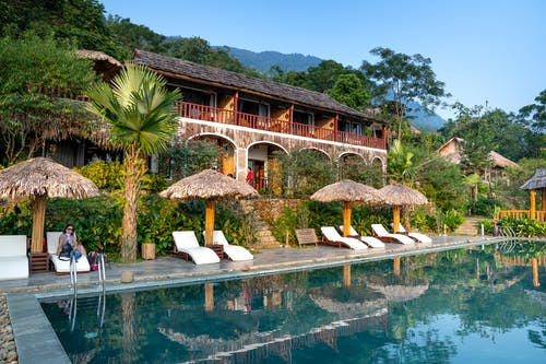 Small hotel with pool in tropical resort