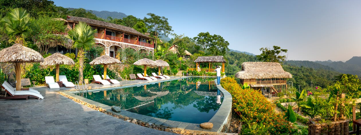 Swimming pool and small hotel on top of hill