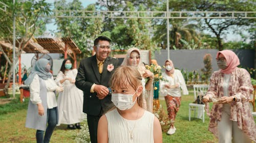 People with protective masks on wedding