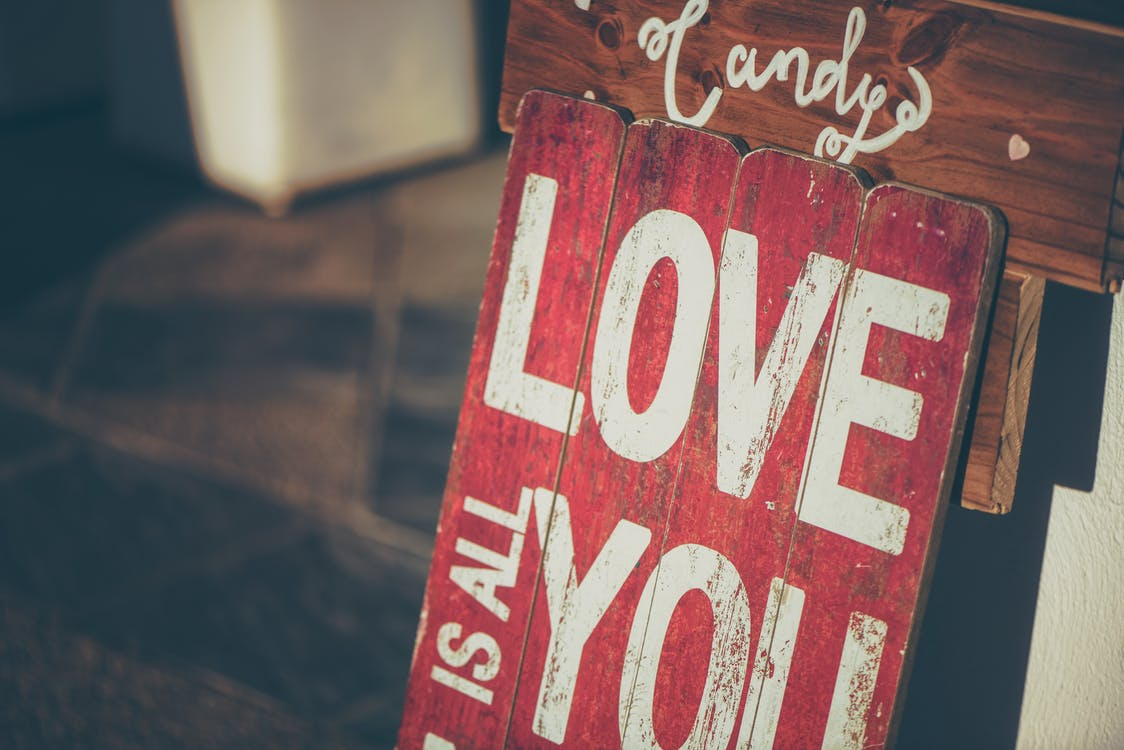 Love Text-printed Board Leaning on Wall