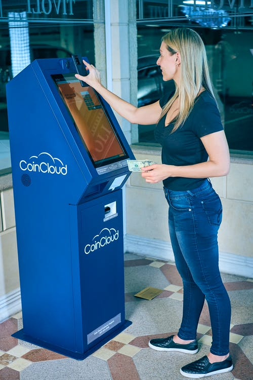 Woman using an Automated Teller Machine