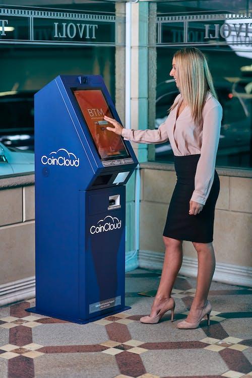 Woman in Formal Wear using ATM
