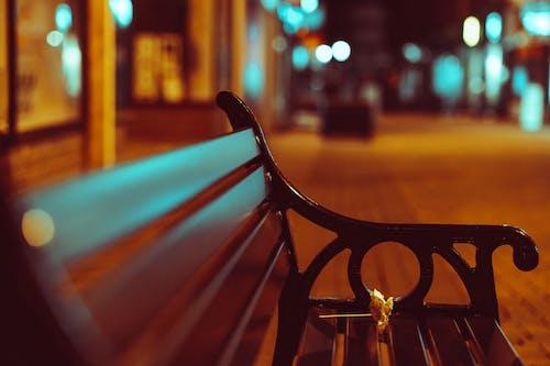 Black Metal Bench Near Road during Night Time