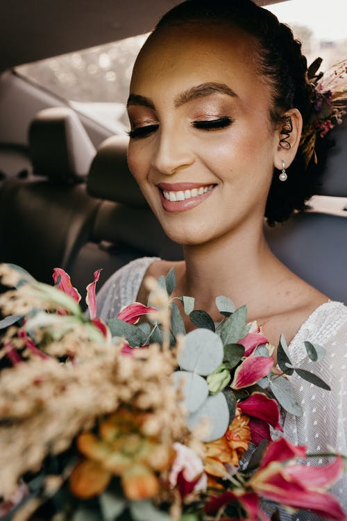 Crop woman with makeup in transport on wedding day